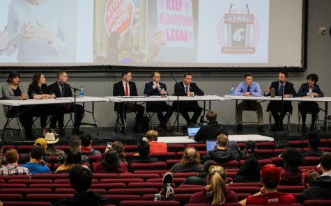 WSU Young Democrats, left, WSU GOP, middle, and Young Americans for Liberty engage in debate during the ASWSU Issues and Forums Political Debate on Tuesday evening at Todd Hall.