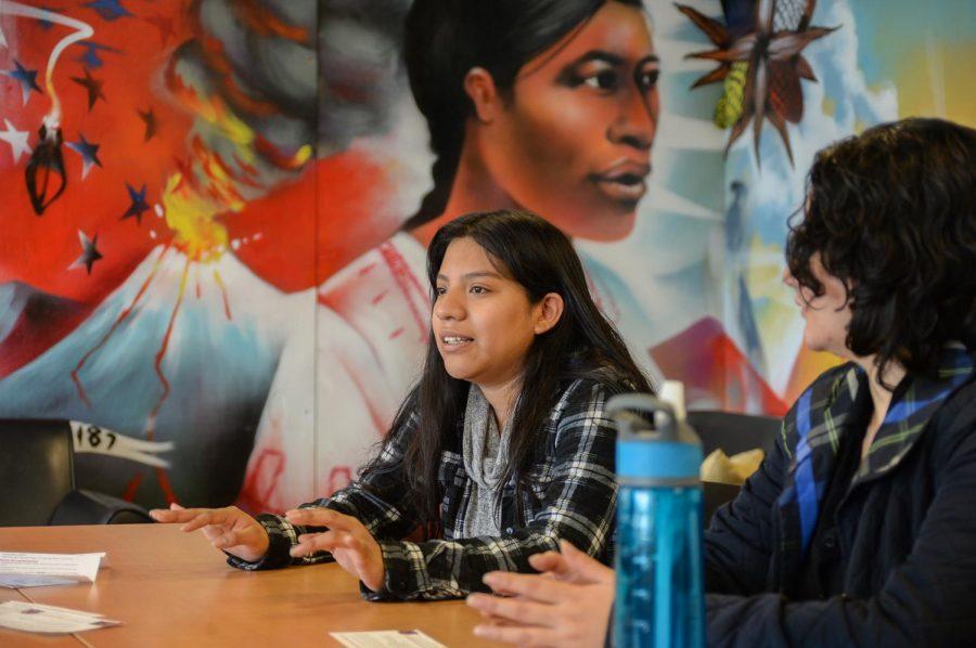 MEChA Representative Carina Gonzalez, left, discusses the meaning of Dia de los Muertos on Oct. 30, 2018 in the CUB.