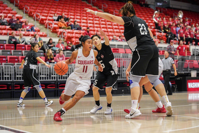 Senior guard Chanelle Molina weaves past Beijing Normal University defenders Thursday night at Beasley Coliseum.