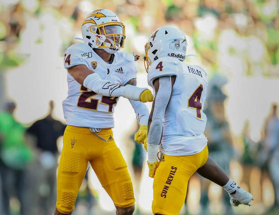 Arizona State defensive backs Chase Lucas (24) and Evan Fields (4) react after a tackle in the third quarter of their college football game against Michigan State at Spartan Stadium in East Lansing, on Saturday, September 14, 2019. Arizona State won the game, 10-7.