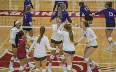 The womens volleyball team celebrates during a match against the University of Washington on Sept. 25, 2019, at Bohler Gym.