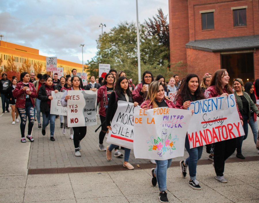 Students and community members of different genders and races show their support in ending sexual and domestic violence during the Take Back the Night march Thursday.