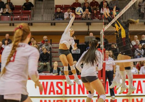 Junior outside hitter and setter Penny Tusa spikes the ball at Arizona State University on Oct. 20 at Bohler Gym.