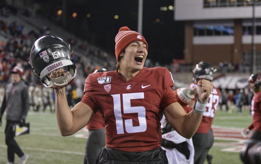 Freshman quarterback Gunner Cruz celebrates after the game Saturday night at Martin Stadium.