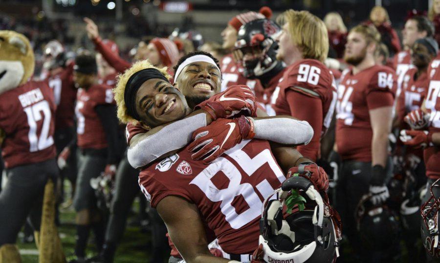 Redshirt-senior+Easop+Winston+Jr.+hugs+senior++wide+receiver+Calvin+Jackson+Jr.+after+winning+the+game+against+OSU+Saturday+night+at+Martin+Stadium.