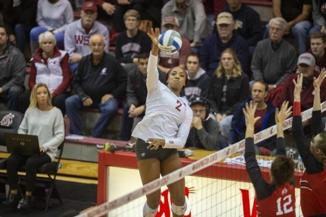 Redshirt freshman Kalyah Williams goes up for the spike against Utah on Friday at Bohler Gym. Williams made six kills and WSU lost 3-1.