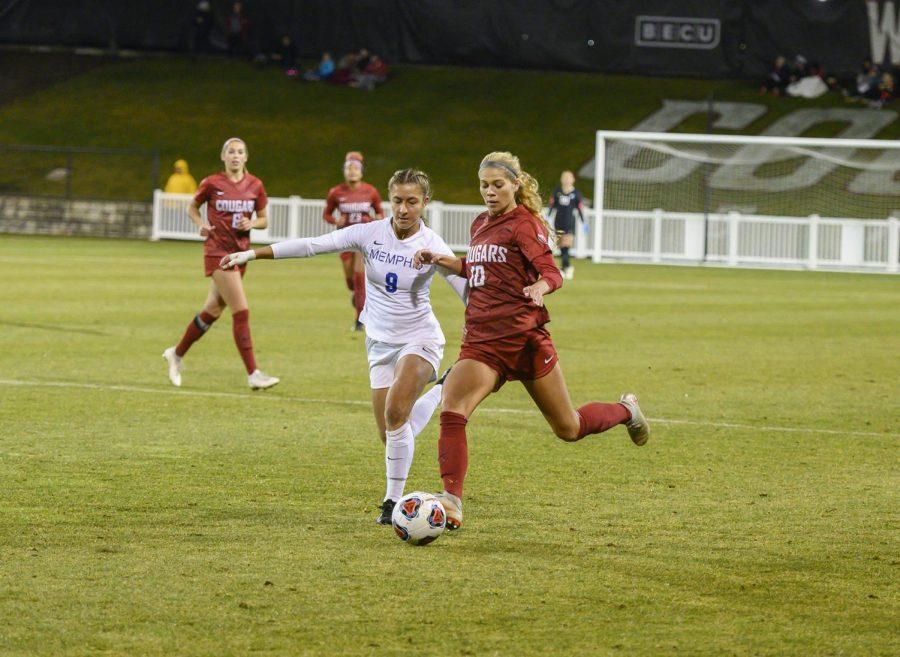 Junior+defender+Brianna+Alger+defends+the+ball+from+Memphis+on+Nov.+15+at+the+Lower+Soccer+Field.