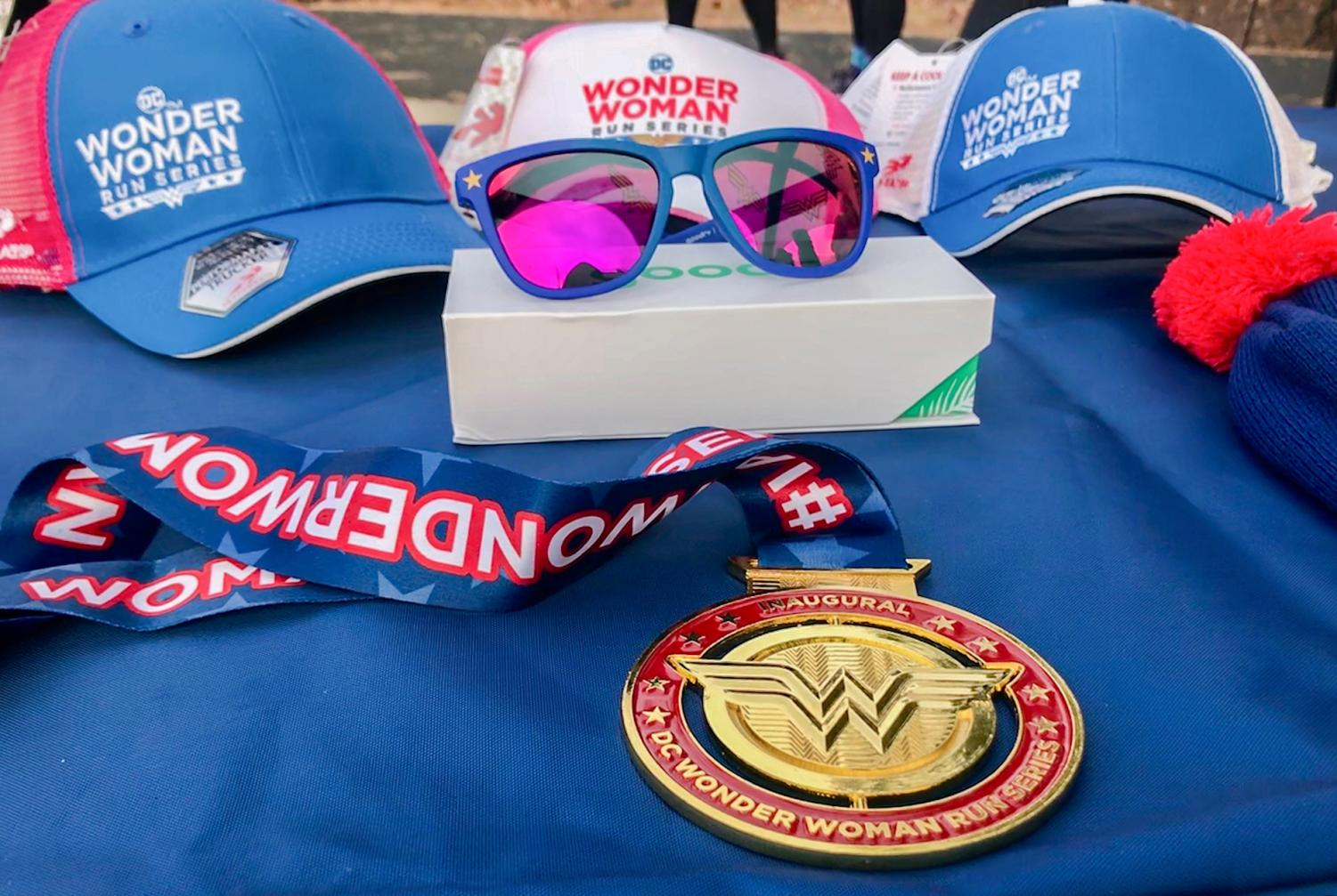 Everyone who participated in the Wonder Woman College Campus 5K run recieved a medal and could purchase other themed items Saturday morning at the Outdoor Recreation Center.