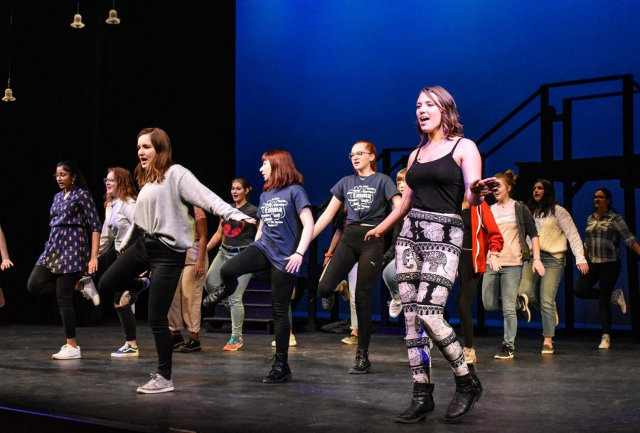 Senior+Keva+Shull%2C+front%2C+plays+the+role+of+Emma.+She+dances+while+cast+members+sing+along+to+%E2%80%9CMan%21+I+Feel+Like+A+Woman%E2%80%9D+by+Shania+Twain+during+a+rehearsal+of+Pullman+High+School%E2%80%99s+new+musical+%E2%80%9CEmma%E2%80%9D+on+Monday+afternoon+in+the+Pullman+High+School+auditorium.+