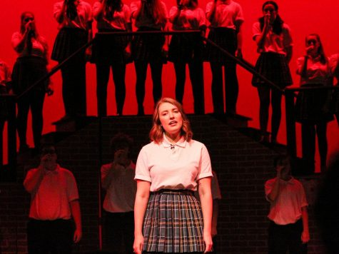 Emma, played by PHS senior Keva Shull, struggles to understand what love is in the play, 'Emma: A Pop Musical,' on Friday night at Pullman High School.