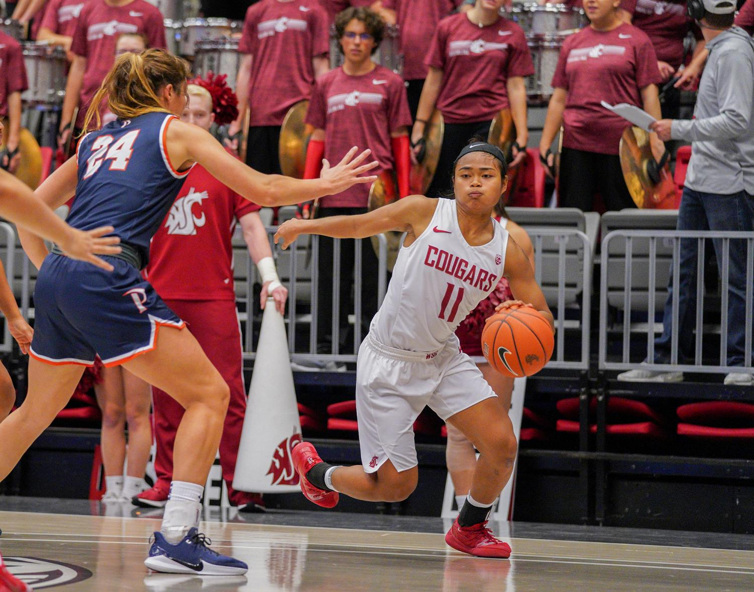 Senior guard Chanelle Molina dribbles against Pepperdine defense on Tuesday night at Beasley Coliseum.