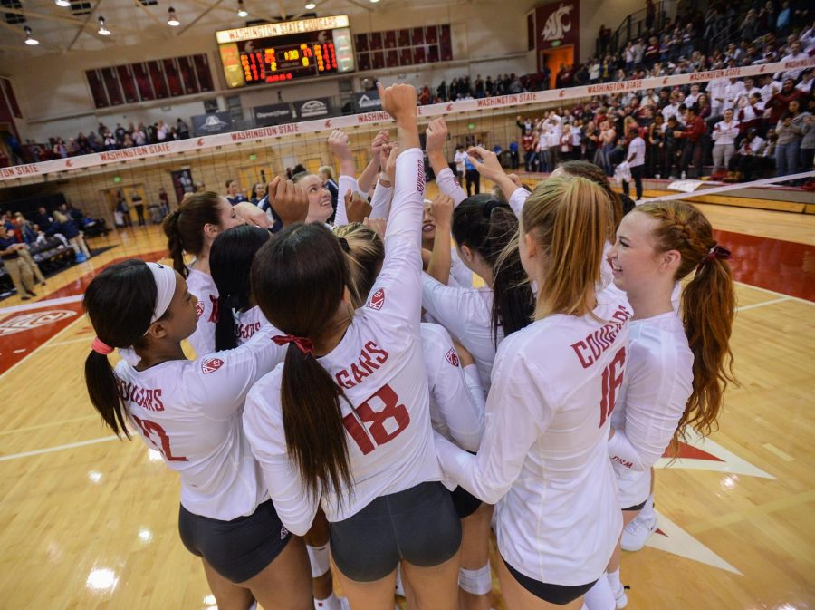 The women's volleyball team celebrates a win over Arizona on Oct. 18 at Bohler Gym.