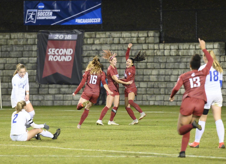 Junior forward Makameae Gomera-Stevens, right, celebrates her goal against Memphis on Nov. 15 at the Lower Soccer Field.