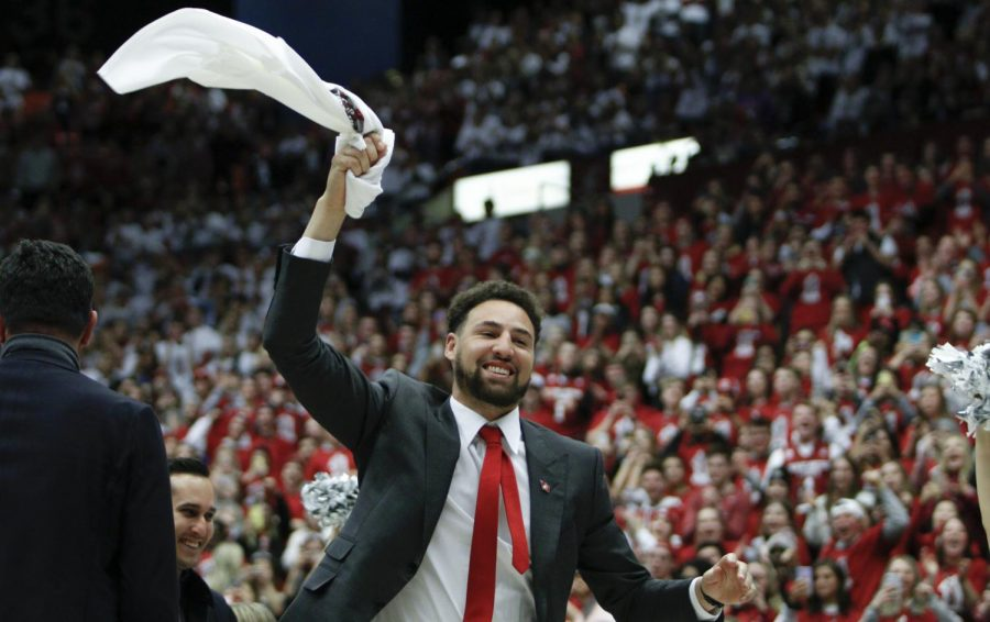 Former WSU basketball player and current NBA player Klay Thmpson waves a shirt above his head during the basketball game against OSU Saturday afternoon at Beasley Coliseum. Thompson had his jersey retired during halftime, becoming the second player to have his jersey retired as a Cougar.