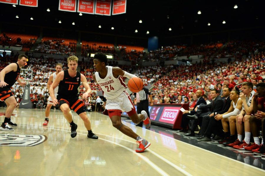 Guard Noah Williams defends the ball against the Oregon State Beavers during the Klay Thompson jersey retirement game on Jan. 18, 2020 at Beasley Coliseum. The Cougars swept the Beavers 89-76.
