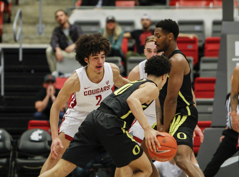 Sophomore forward CJ Elleby attempts to slow down Oregon offense on Jan. 16 at Beasley Coliseum.