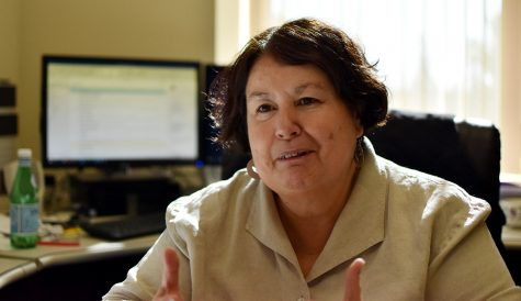 Professor Vilma Navarro-Daniels talks about Spanish literature and film Friday at noon in her office in Thompson Hall. Navarro-Daniels says she enjoys getting to discuss films with students, especially when they are willing to read subtitles to understand.