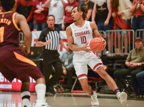 Junior guard Isaac Bonton looks to make a move against Arizona State on Jan. 29 at Beasley Coliseum. The Cougars won the game 67-65.