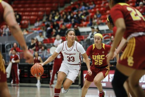 Sophomore guard Cherilyn Molina dribbles up the court against USC on Jan. 24 at Beasley Coliseum.