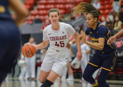 Redshirt senior forward Borislava Hrisova attempts to dribble past California defense on Jan. 31 at Beasley Coliseum.