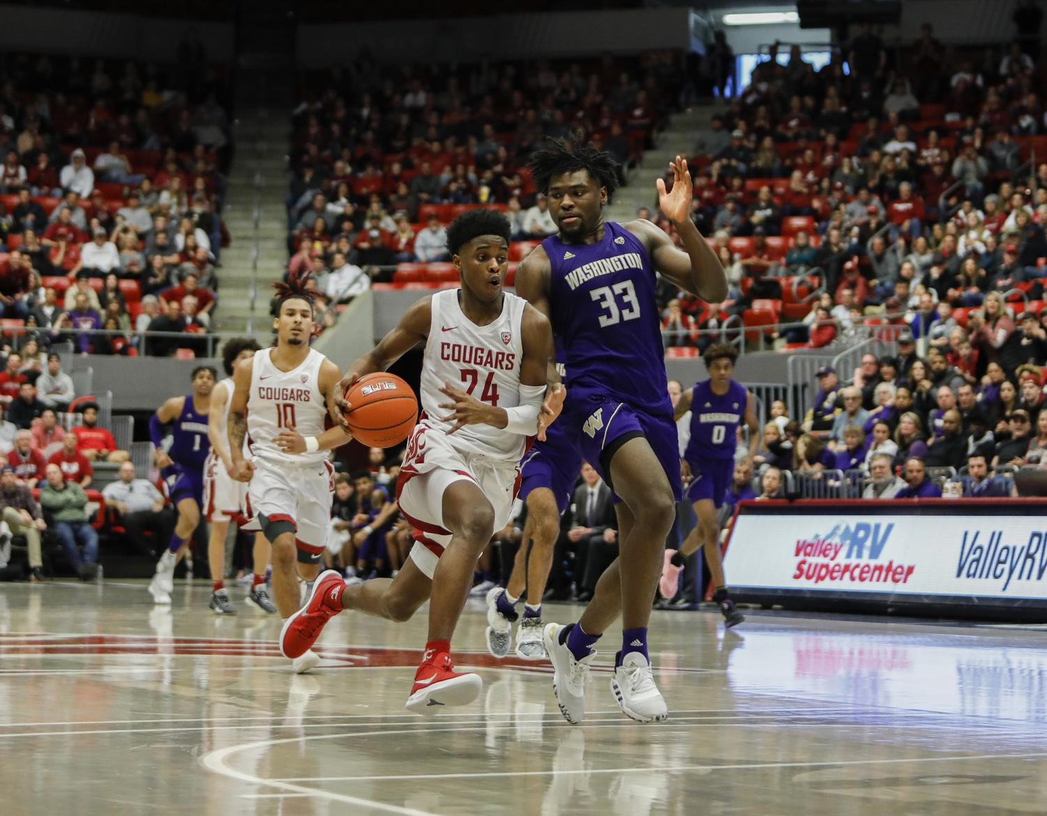 Freshman guard Noah Williams battles his way up the court against UW on Sunday at Beasley Coliseum.