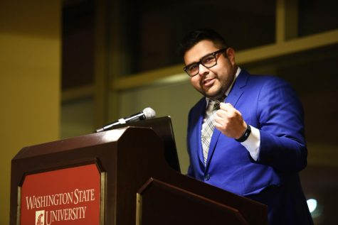 Luis Cortes Romero, an immigration attorney, speaks about the conditions of the detention center located in Tacoma, Wash. on Monday night in the CUB Junior Ballroom. He says looking for financial help from university private funds may help some students