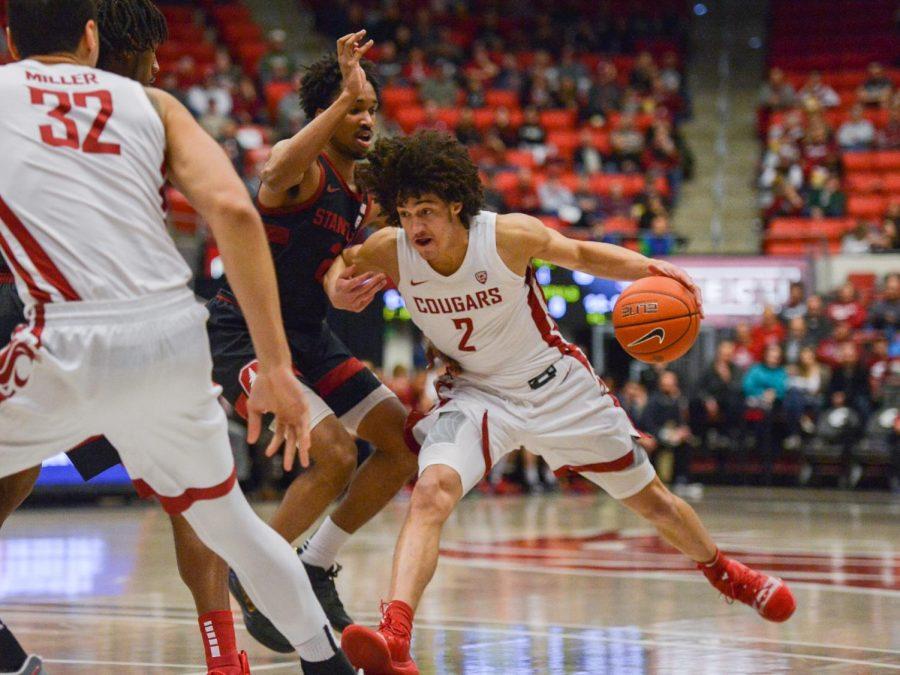 Sophomore Forward C.J Elleby makes a move on Stanford defense on Feb. 23 at Beasley Coliseum.