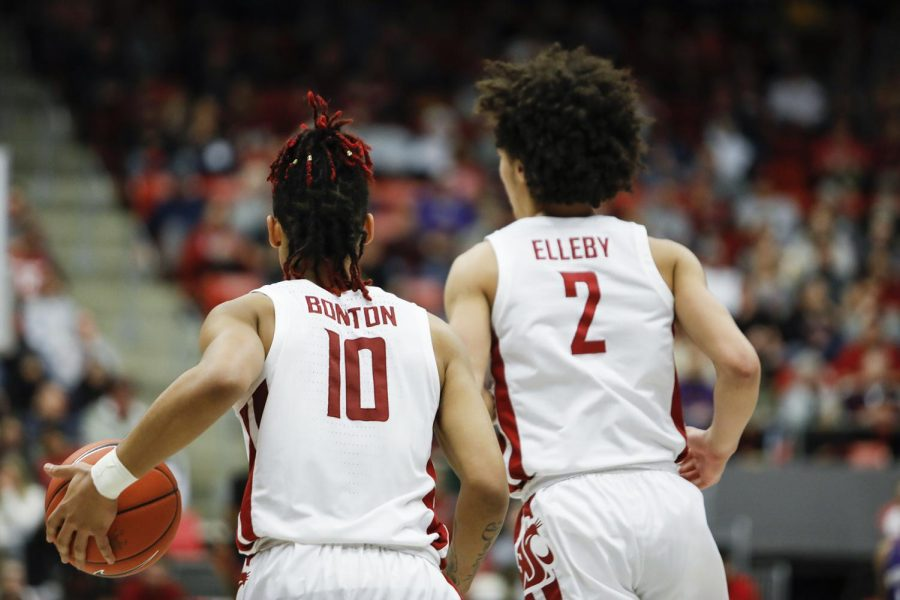 Junior+guard+Isaac+Bonton%2C+left%2C+and+Sophomore+forward+CJ+Elleby%2C+right%2C+prepare+for+play+against+UW+on+Feb.+9+at+Beasley+Coliseum.