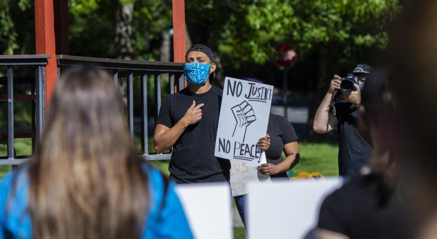 Demonstrator Jose Amarillas speaks to crowds at Reaney Park.