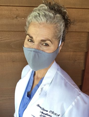 Shawn Brow, nurse anesthetist in Spokane and adjunct faculty with the Elson S. Floyd College of Medicine, wears a mask that she and her team designed.