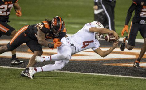 True freshman quarterback Jayden de Laura dives into the endzone to extend the Cougars