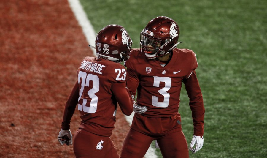 Freshman defensive back Chau Smith-Wade, left, celebrates with redshirt senior defensive back Daniel Isom after breaking up a pass in the end zone Saturday night in Martin Stadium.