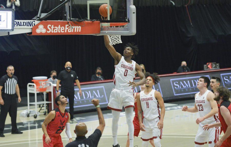 Freshman center Efe Abogidi picks the ball off the top of the hoop against EWU on Nov. 28, 2020.