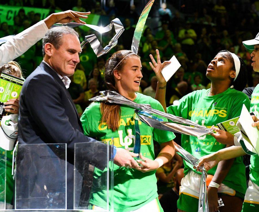 Larry Scott celebrates with Oregon alumna Sabrina Ionescu.