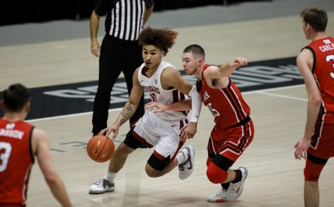 Senior guard Isaac Bonton attempts to get past a Utah defender during Thursday