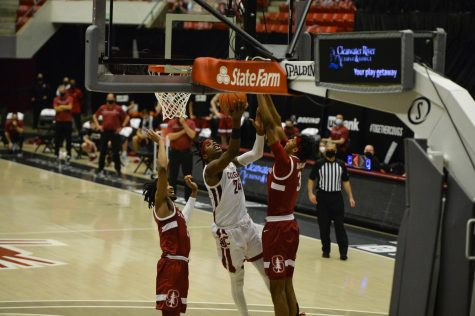 Sophomore guard Noah Williams goes for a layup between Stanford's junior guard Bryce Wills and freshman forward Ziaire Williams during the matchup Saturday afternoon in Beasley Coliseum.