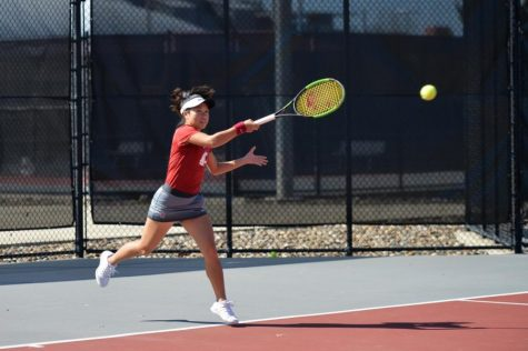 Then-freshman Savanna Ly-Nguyen hits the tennis ball back toward her opponent on Mar. 31, 2019 at the Outdoor Tennis Courts.