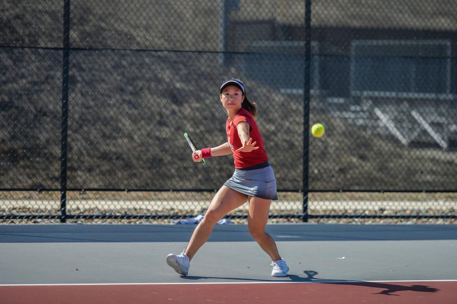 Then-freshman Savanna Ly-Nguyen hits the tennis ball back towards her opponent on Mar. 31, 2019 at the Outdoor Tennis Courts.