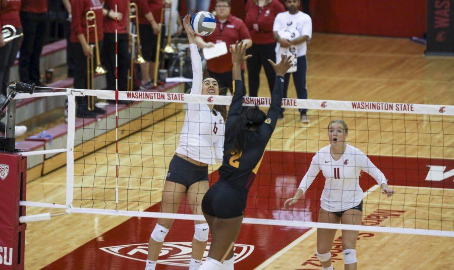 WSU alum Jocelyn Urias attempts to spike ball.