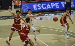 Freshman forward Andrej Jakimovski passes ball to teammate against Stanford on Feb. 20 in Beasley Coliseum.