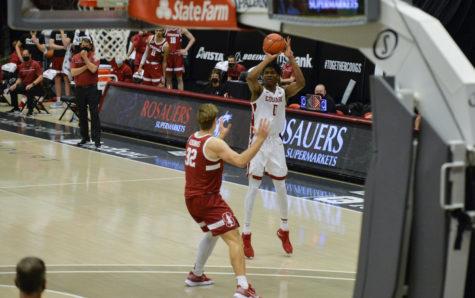 Freshman forward Efe Abogidi shoots a three-point shot over Stanford's junior forward Lukas Kisunas during the matchup Feb. 20 in Beasley Coliseum.