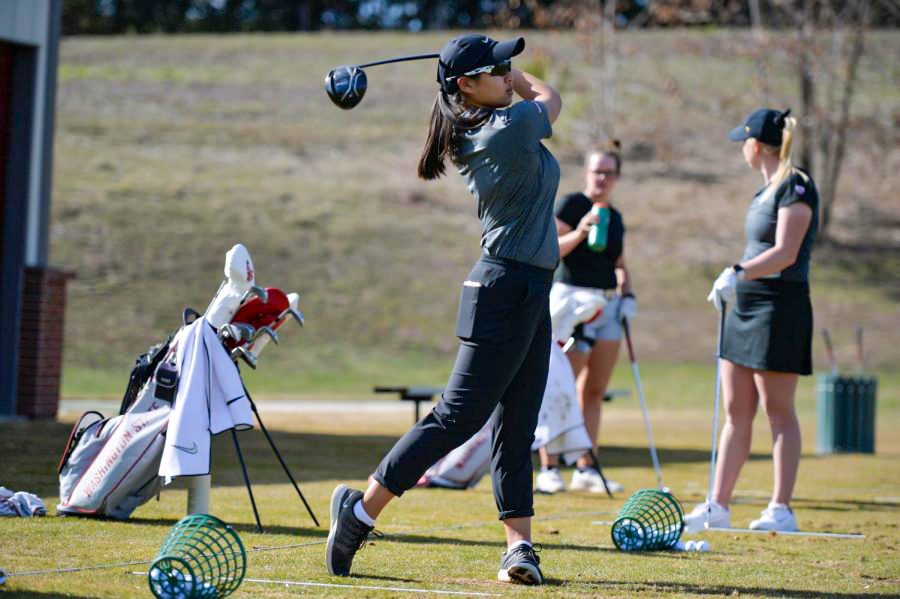 Junior Amy Chu warms up with some practice shots on the driving range.