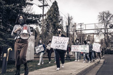 Jiemei Lin leads a group of protestors down Lentil Ln. towards downtown Pullman.