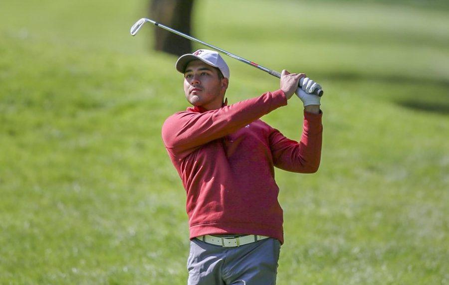 Then-senior golfer Daniel Kolar watches his shot as it heads towards the green.