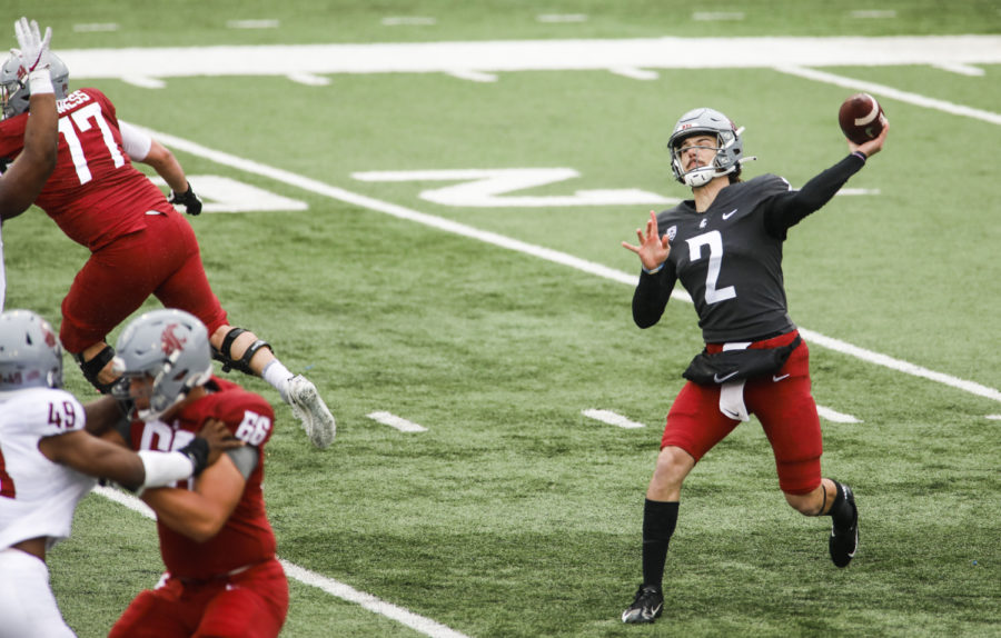 Redshirt junior quarterback Cammon Cooper throws the ball during the Crimson and Gray football game on Saturday at Martin Stadium.
