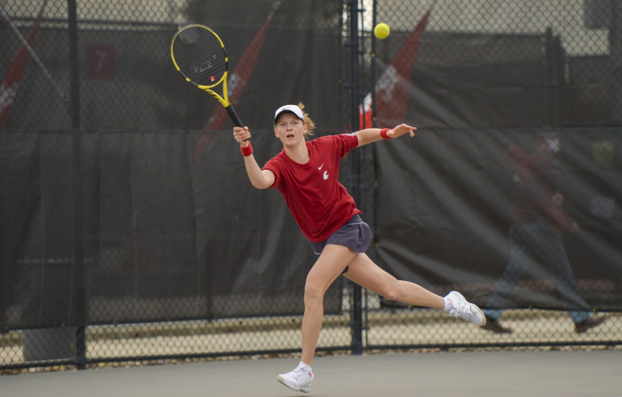 Senior Michaela Bayerlova returns the ball during a singles match against Arizona March 14 at the WSU Outdoor Tennis Courts.