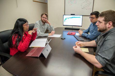 Left to right, Jan Dasgupta, Clark Kogan, Ziyi Chen and Tim Neumann discuss WSU's Center for Interdisciplinary Statistics Education and Research.