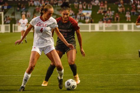 WSU forward Elyse Bennett pressures Seattle University defender Kait Raffensperger Sept. 13 at the Lower Soccer Field.