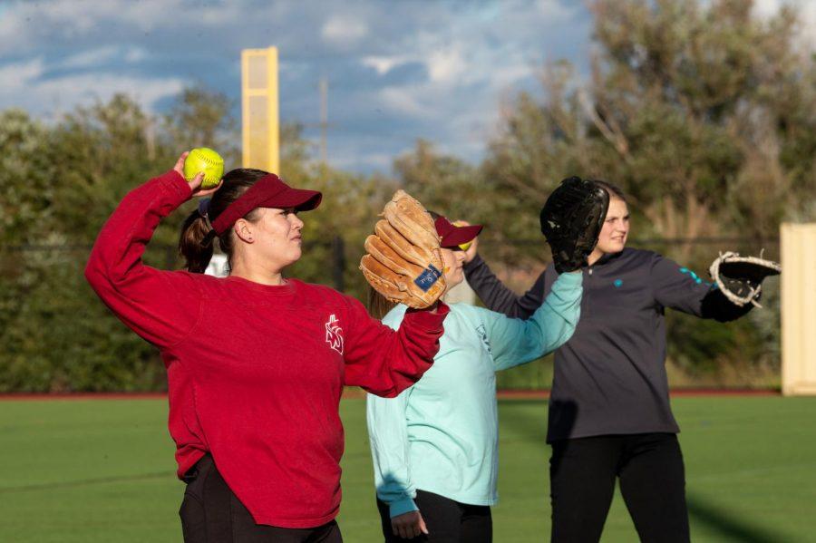 WSU Fastpitch Club member Sam Shaffer warms up with her teammates.
