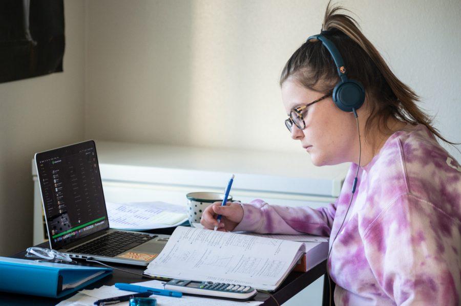 Hannah Ericsson (senior) studies at her desk to her favorite tunes.